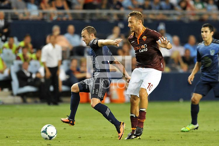 Sporting Park, Kansas City, Kansas, July 31 2013:<br /> Brad Davis (11) midfield MLS All-Stars  goes past Francesco Totti (10) forward AS Roma .<br /> MLS All-Stars were defeated 3-1 by AS Roma at Sporting Park, Kansas City, KS in the 2013 AT &amp; T All-Star game.
