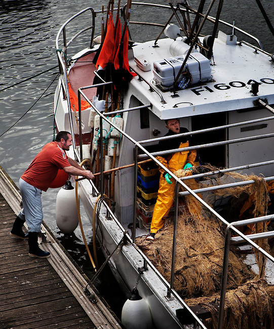Sorting the nets on one of the 65 small-scale fishing boats in the port of Boulogne-sur-Mer, France.<br />