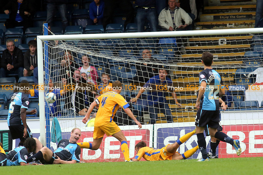 Ollie Palmer lies on the ground after heading the ball into the net to score Mansfield's first league goal of the season and secure a vital 1-0 away victory - Wycombe Wanderers vs Mansfield Town - Sky Bet League Two at Adams Park, High Wycombe - 17/08/13 - MANDATORY CREDIT: Paul Dennis/TGSPHOTO - Self billing applies where appropriate - 0845 094 6026 - contact@tgsphoto.co.uk - NO UNPAID USE