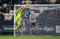 Goalkeeper Adam Collin of Notts Co punches clears of Scott Kashket of Wycombe Wanderers during the Sky Bet League 2 match between Notts County and Wycombe Wanderers at Meadow Lane, Nottingham, England on 10 December 2016. Photo by Andy Rowland.