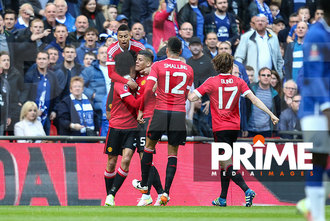 Marouane Fellaini of Manchester United (left) celebrates scoring the opening goal against Everton during the FA Cup Semi-Final match between Everton and Manchester United at Wembley Stadium, London, England on 23 April 2016. Photo by David Horn / PRiME Media Images.