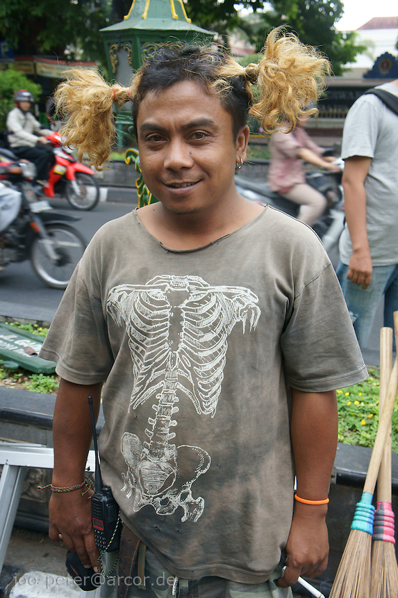 young technician working for a film production in  the streets of Yogyakarta, island Java, archipelago of Indonesia,  September 2011. Yogyakarta is famous for cultural life, many students, intellectuals, artists (traditional as contemporary) live here, also  a many film and television teams can been seen shooting in the streets here.