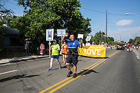 AUSTIN, TEXAS - Austin Police Chief Art Acevedo waves to the residents of East Austin while filming the event on his smartphone during the 2016 Central Texas Juneteenth Celebration Parade on Sat. June 18, 2016. <br /> <br /> Use of this image in advertising or for promotional purposes is prohibited.<br /> <br /> Editorial Credit: Dan Herron / Herronstock Editorial.