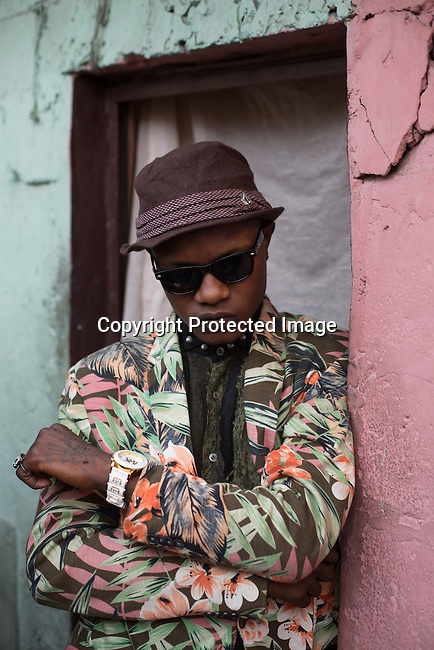 "KINSHASA, DEMOCRATIC REPUBLIC OF CONGO - OCTOBER 10: A Sapeur from the group belonging to The Leopards poses for a portrait February 10, 2015 in Kinshasa, DRC. The word Sapeur comes from SAPE, a French acronym for Société des Ambianceurs et Persons Élégants. or Society of Revellers and Elegant People. and it also means, .to dress with elegance and style"". Most of the young Sapeurs are unemployed, poor and live in harsh conditions in Kinshasa, a city of about 10 million people. For many of them being a Sapeur means they can escape their daily struggles and dress like fashionable Europeans. Many hustle to build up their expensive collections. Most Sapeurs could never afford to visit Paris, and usually relatives send or bring clothes back to Kinshasa. (Photo by Per-Anders Pettersson)"