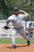 Jake Woods of the Rancho Cucamonga Quakes pitches during a game against the Inland Empire 66ers at Stater Bros Stadium on July 4, 2003 in San Bernardino, California. (Larry Goren/Four Seam Images)