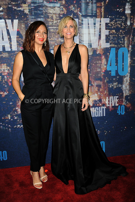 WWW.ACEPIXS.COM<br /> February 15, 2015 New York City<br /> <br /> Maya Rudolph  and Kristen Wiig walking the red carpet at the SNL 40th Anniversary Special at 30 Rockefeller Plaza on February 15, 2015 in New York City.<br /> <br /> Please byline: Kristin Callahan/AcePictures<br /> <br /> ACEPIXS.COM<br /> <br /> Tel: (646) 769 0430<br /> e-mail: info@acepixs.com<br /> web: http://www.acepixs.com