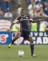 New England Revolution midfield Dimitry Imbongo (92) attempts to control the ball. In a Major League Soccer (MLS) match, Sporting Kansas City defeated the New England Revolution, 1-0, at Gillette Stadium on August 4, 2012.