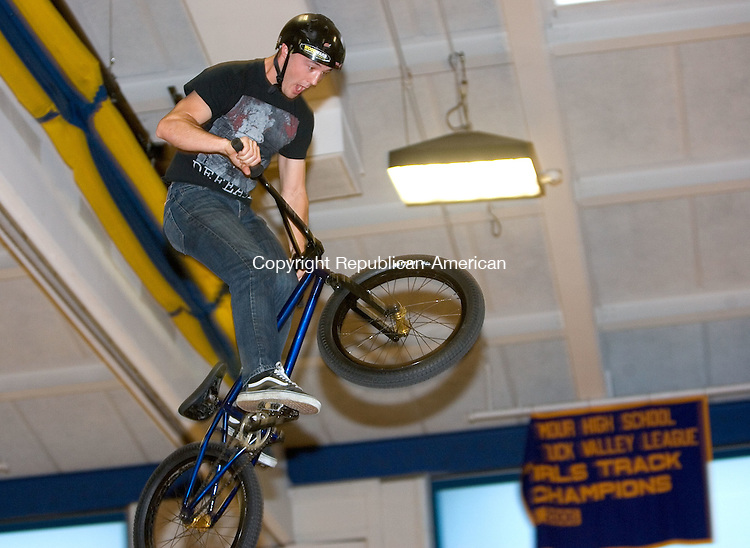 SEYMOUR, CT. 01 May 2012-050112SV04-Mike Payne of Las Vegas, NV. does a trick off a ramp high above students in the gym at Seymour High in Seymour Tuesday. The X-Games athletes performed at the school as part of the Campaign for Tobacco-Free Kids. The group was talking about the negative aspects of tobacco and how the market targets youth..Steven Valenti Republican-American