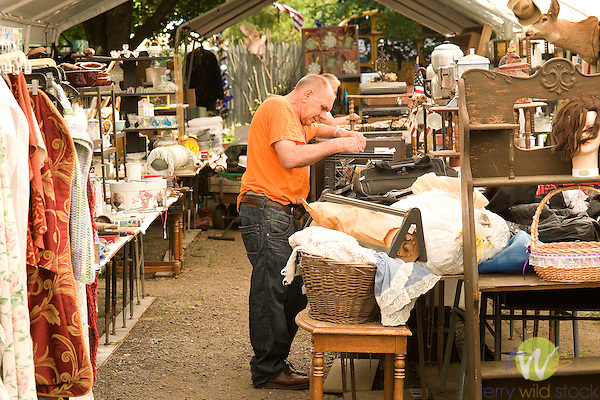 Man searching at flea market.