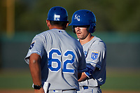 AZL Royals Jimmy Govern (8) talks to hitting coach Ramon Castro (62) after getting a hit during an Arizona League game against the AZL White Sox at Camelback Ranch on June 19, 2019 in Glendale, Arizona. AZL White Sox defeated AZL Royals 4-2. (Zachary Lucy/Four Seam Images)