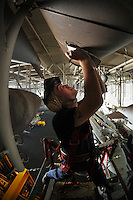 080531-N-7981E-080 ARABIAN GULF (May 31, 2008)- Storekeeper 3rd Class Josh Hall, assigned to Supply Department's S-6 Division, records serial numbers on aircraft external fuel tanks stored in the overhead of the hangar bay of Nimitz-class aircraft carrier USS Abraham Lincoln (CVN 72) while conducting an inventory. Lincoln is deployed to the U.S. Navy 5th Fleet area of responsibility to support Maritime Security Operations (MSO).  MSO help develop security in the maritime environment, which promotes stability and global prosperity.  These operations complement the counterterrorism and security efforts of regional nations and seek to disrupt violent extremists' use of the maritime environment as a venue for attack or to transport personnel, weapons or other material.  U.S Navy photo by Mass Communication Specialist 2nd Class James R. Evans (RELEASED)