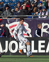 DC United forward Chris Pontius (13) brings the ball forward. In a Major League Soccer (MLS) match, the New England Revolution defeated DC United, 2-1, at Gillette Stadium on March 26, 2011.