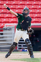 Catcher Kyle Skipworth #11 of the Greensboro Grasshoppers makes a throw to first base against the Hickory Crawdads at  L.P. Frans Stadium July 10, 2010, in Hickory, North Carolina.  Photo by Brian Westerholt / Four Seam Images