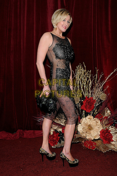 BRONAGH WAUGH.Attending The British Soap Awards 2010, The London Television Centre, London, England, UK, 8th May 2010 .arrivals full length black sheer see thru through mesh beaded sleeveless dress platform shoes side feather feathers clutch bag .CAP/CAN.©Can Nguyen/Capital Pictures.