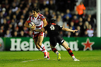 James Hook of Gloucester Rugby goes round Sam Hidalgo-Clyne of Edinburgh Rugby