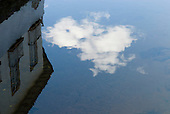 Goias Velho, Brazil. Well preserved colonial town. Reflection of colonial building in the water of the River Vermelho.