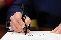 US President Donald J. Trump signs 'the Women's Suffrage Centennial Commemorative Coin Act', in the Oval Office of the White House in Washington, DC, USA, 25 November 2019. Trump signed 'H.R. 2423, the Women's Suffrage Centennial Commemorative Coin Act' - a bill directing the US Treasury to mint and issue up to four hundred thousand one-dollar silver coins honoring women that played a role in gathering support for the 19th Amendment.<br /> Credit: Michael Reynolds / Pool via CNP/AdMedia