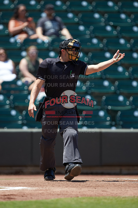 Home plate umpire Steven Hodgins works the Carolina League game between the Lynchburg Hillcats and the Winston-Salem Rayados at BB&T Ballpark on June 23, 2019 in Winston-Salem, North Carolina. The Hillcats defeated the Rayados 12-9 in 11 innings. (Brian Westerholt/Four Seam Images)