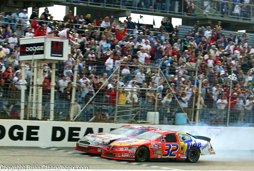 Ricky Craven and Kurt Busch bang togoehter as they cross under the checkered flag in the closest finish in NASCAR history at Darlington in March 2003. (Poto by Brian Cleary)DIGITAL  The Carolina Dodeg Dealers 400 NASCAR WInston Cup race at Darlington Raceway, Darlington, SC, March 16, 2003.  (Photo by Brian Cleary/www.bcpix.com)