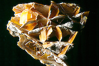 WULFENITE (PbMoO4) Lead Molybdate<br /> Yellow Lead Ore<br /> Wulfenite is a lead molybdate mineral with the formula PbMoO4. Tetragonal-Tetragonal pyramidal; tabular crystal development