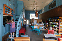NWA Media/ J.T. Wampler - Lisa Sharp, owner of Nightbird Books in Fayetteville answers the phone Wednesday August 27, 2014 at the store's new location.