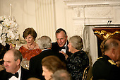 Washington, D.C. - November 2, 2005 -- First lady Laura Bush, left, and former United States President George H.W. Bush, right, raise their glasses in honor of Charles, Prince of Wales, and Camilla, Duchess of Cornwall, of Great Britain, during a social dinner at the White House in Washington, D.C. on November 2, 2005. .Credit: Jay L. Clendenin - Pool via CNP.(Restriction: No New York Metro or other Newspapers within a 75 mile radius of New York City)