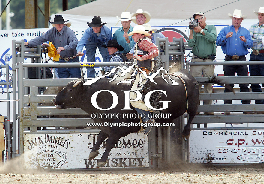 28 August 2005: Greg Fuller riding the bull Bush Hog holds on during the Extreme Bulls competition Sunday at the Kitsap County Fair Grounds, Fuller scored a 81 in the first round of competition in Bremerton, WA.