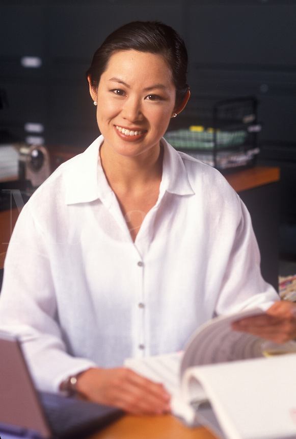 Pleasant smiling woman in office setting.
