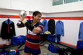 Tekori Luteru raises the McNamara cup as fellow players arrive back into the changing room. CMRFU Counties Power 2008 Club rugby McNamara Cup Premier final between Ardmore Marist & Patumahoe played at Growers Stadium, Pukekohe on July 26th.  Ardmore Marist won 9 - 8.