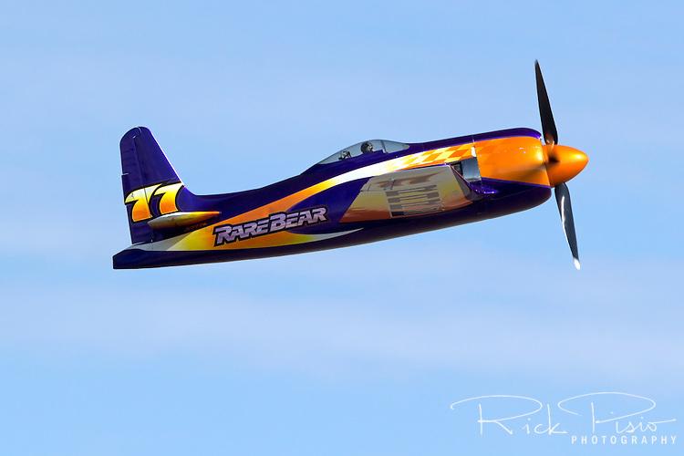 """Unlimted Air Racer """"Rare Bear"""" in flight."""