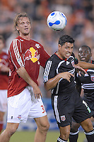DC United midfielder Christian Gomez (10) heads the ball away from Red Bulls midfielder Markus Schopp (32).  DC United defeated the New York Red Bulls 4-3. DC United earned a top seed in the 2006 MLS Playoffs and will enjoy home field advantage for the entire Eastern Conference Playoffs. Saturday, September 23, 2006, at RFK Stadium.