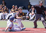 Reno's Duncan Wilmot slides safely under the tag of Galena pitcher Cohen Kreitlein in the NIAA Division I Northern Region Baseball Championship between the Galena Grizzlies and the Reno Huskies played on Saturday, May 14, 2016 at Peccole Park in Reno, Nevada.