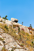 Precarious boulder on granite mountain face, Acadia National Park, Maine, USA