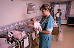 Portland Private hospital London 1990 Nursery nurse caring for new born baby 1990s UK.