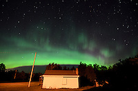 The beautiful northern lights viewed over an abandoned home in the rural Upper Peninsula of Michigan.
