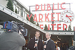 20 November 2009: ESPN broadcasters John Harkes (left) and JP Dellacamera (right) tape an introduction to the ESPN coverage of the MLS fish toss. Major League Soccer players Alan Gordon of the Los Angeles Galaxy and Chris Seitz of Real Salt Lake took part in a fish toss at Pike Place Market in Seattle, WA as part of the Major League Soccer MLS Cup weekend activities.