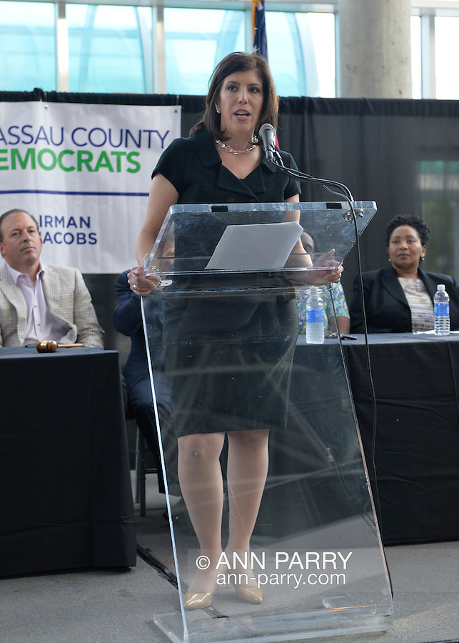 Garden City, New York, USA. 26th May 2015. MADELINE SINGAS, Acting District Attorney of Nassau County, speaks at the podium during the Nassau County Democrats nominating convention. Singas, a Greek-American, who is running for Nassau County D.A., became acting DA when D.A. Rice resigned to join Congress, and is one of 55 candidates the executive committee nominated for races.