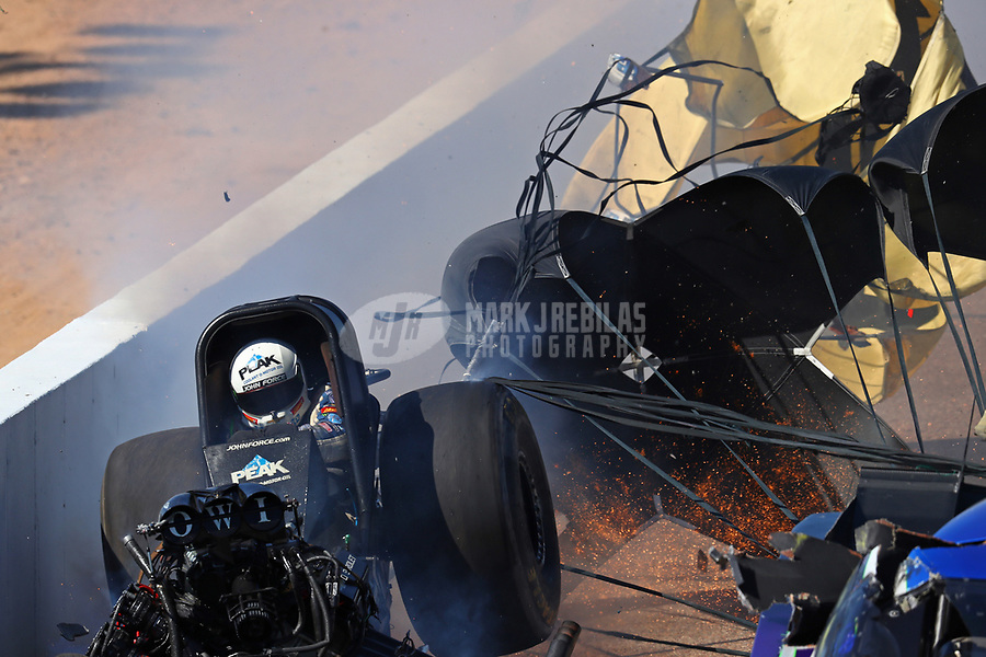 Feb 25, 2018; Chandler, AZ, USA; NHRA funny car driver John Force crashes during the Arizona Nationals at Wild Horse Pass Motorsports Park. Mandatory Credit: Mark J. Rebilas-USA TODAY Sports