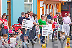 Parents and children assemble in Newcastle West last Friday to protest over cuts to rural bus services ahead of the arrival of Enda Kenny to the town.