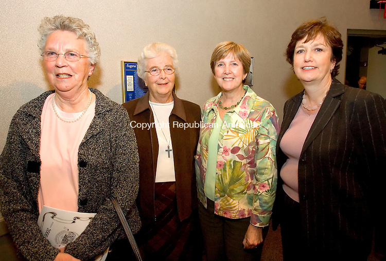 WATERBURY, CT-28 OCTOBER 2006-102806JS05-Family members of former Waterbury Mayor, the late Martin Scully, from left, Mary Scully Ahearn of Madison, Sister Ann Moore of Waterbury, Kathy Donohue of Holliston, Mass., and Maive Scully of Fairfield at the  Silas Bronson Library's Waterbury Hall of Fame induction ceremony Saturday at the Timexpo Museum in Waterbury. -Jim Shannon Republican-American