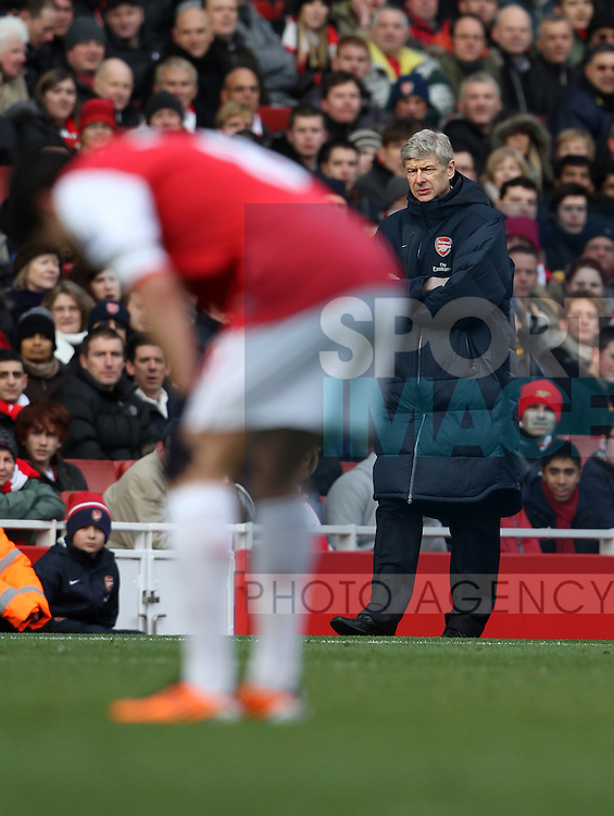 Arsenals Arsene Wenger looks on as Samir Nasri goes off injured with a hamstring problem