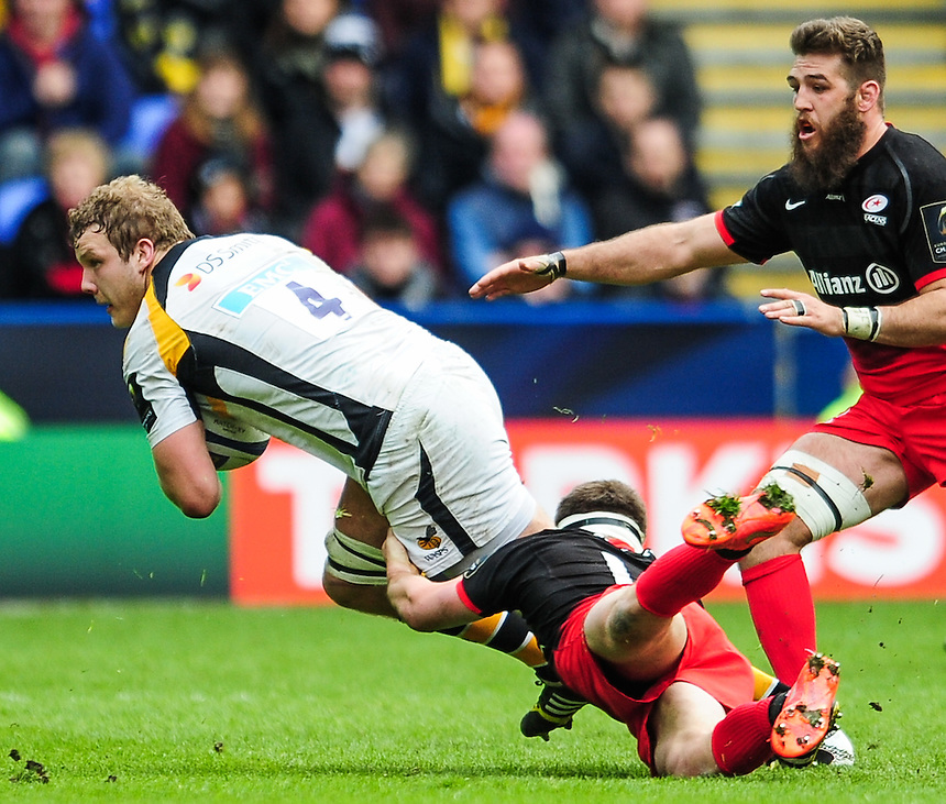 Wasps' Joe Launchbury is tackled by Saracens' Owen Farrell<br /> <br /> Photographer Craig Thomas/CameraSport<br /> <br /> Rugby Union - European Rugby Champions Cup Semi Final - Saracens v Wasps - Saturday 23rd April 2016 - Madejski Stadium - Reading<br /> <br /> &copy; CameraSport - 43 Linden Ave. Countesthorpe. Leicester. England. LE8 5PG - Tel: +44 (0) 116 277 4147 - admin@camerasport.com - www.camerasport.com