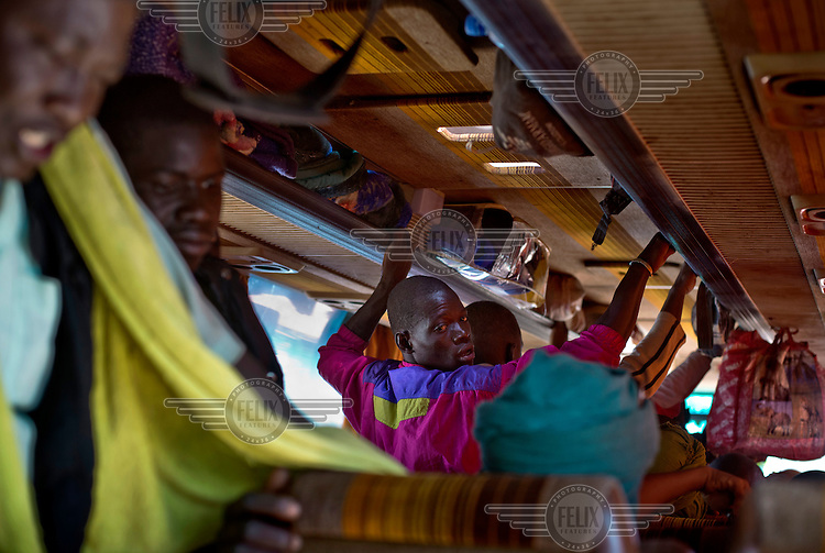 Passengers standing in the aisle of a bus travelling from Sevare to Gao, a journey of 560 kms that takes over 24 hours on a road in a state of disrepair.