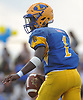 Christian Fredericks #1, Lawrence quarterback, scrambles out of th pocket during a Nassau County Conference III varsity football game against Bethpage at Lawrence High School on Saturday, Oct. 7, 2017. He ran for two touchdowns in Lawrence's 35-31 win.