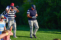 Kevin Kisner (USA) and Phil Mickelson (USA) make their way down 17 during round 1 foursomes of the 2017 President's Cup, Liberty National Golf Club, Jersey City, New Jersey, USA. 9/28/2017.<br /> Picture: Golffile | Ken Murray<br /> ll photo usage must carry mandatory copyright credit (&copy; Golffile | Ken Murray)