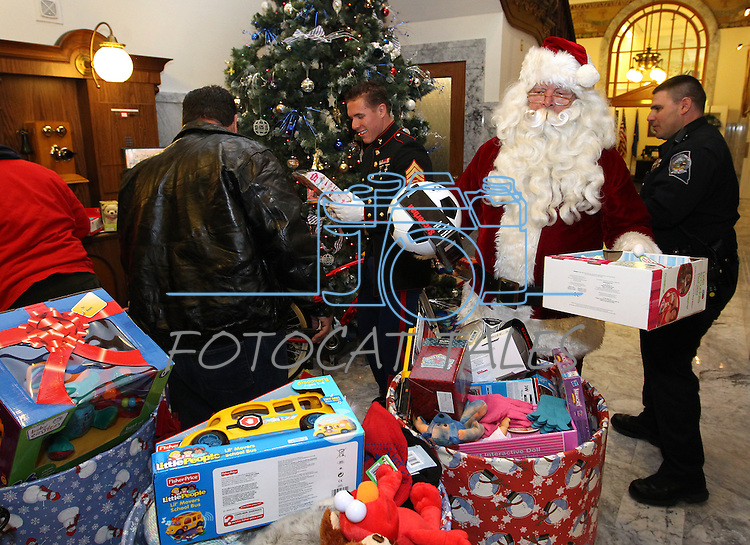 Workers gather up donated toys from the 8th annual Toys for Tots toy drive coordinated by the Capitol Police at the Capitol in Carson City, Nev. on Friday, Dec. 17, 2010. More than a dozen state agencies participated in the event which helps more than 7,000 kids in Carson, Douglas, Lyon and Storey counties..Photo by Cathleen Allison