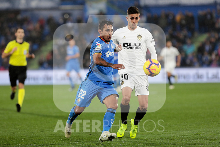 Getafe CF's Damian Suarez and Valencia CF's Ferran Torres during La Liga match between Getafe CF and Valencia CF at Coliseum Alfonso Perez in Getafe, Spain. November 10, 2018.