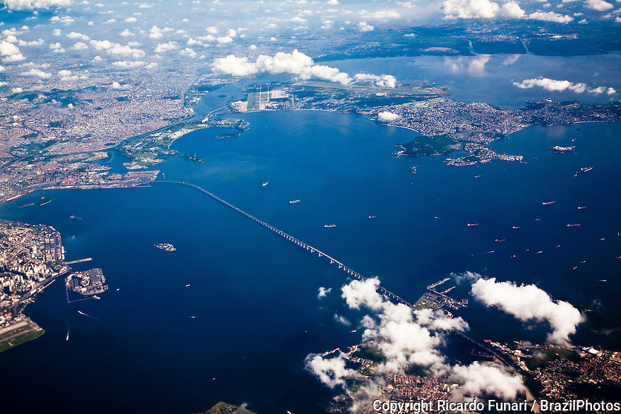 Aerial view of Guanabara Bay, on its western shore lies the city of Rio de Janeiro, and on its eastern shore the city of Niteroi - it is crossed by the Rio-Niteroi Bridge, there is heavy boat and ship traffic, and The Antonio Carlos Jobim International Airport ( on Governador Island in background ) is located on its shores. The bay has been heavily impacted by urbanization, deforestation, and pollution of its waters with sewage, garbage, and oil spills.