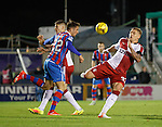 Martyn Waghorn steams in with Brad McKay