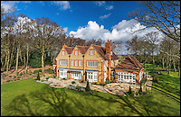 BNPS.co.uk (01202 558833)<br /> Pic: Savills/BNPS<br /> <br /> ***Please use full byline***<br /> <br /> Beechwood House near Dippenhall, Surrey. 6 beds, guide price &pound;4.25m<br /> <br /> To the Manor Reborn...<br /> <br /> Britain's super rich are turning their backs on the decaying stately piles beloved by the aristocracy and building brand new modern mansions on their country estates.<br /> <br /> Rather than investing in the leaky roofs and draughty windows of days gone by, modern millionaires are choosing to build plush pads from the ground up.<br /> <br /> And they are filling their dream homes with every conceivable luxury without the need for a bottomless sink fund to pay for the costly upkeep of older houses.<br /> <br /> Estate agents specialising in top-end properties have reported a clear swing from grand Victorian manor houses to state of the art modern homes kitted out with all the mod cons.<br /> <br /> The multi-million pounds properties have been popping up across the country over the past few years - and are now being heralded as the stately homes of the future.
